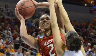 Maryland's Alyssa Thomas, left, shoots over the defense of Tennessee's Cierra Burdick during the second half in a regional semifinal game at the NCAA women's college basketball tournament on Sunday, March 30, 2014, in Louisville, Ky. Maryland defeated Tennessee 73-62. (AP Photo/Timothy D. Easley)