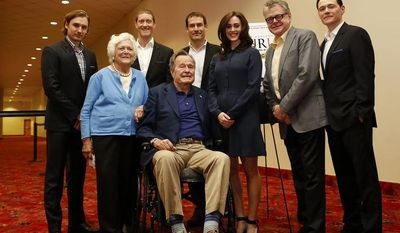 IMAGE DISTRIBUTED FOR AMC - Former President George H.W. Bush, center, former first lady Barbara Bush, second from the left, and the cast of AMC's new series TURN attend a private screening on Saturday, March, 29, 2014 in Houston, Texas. (Photo by Aaron M. Sprecher/Invision for AMC/AP Images)