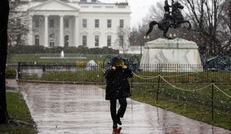 An officer with the Uniform Division of the U.S. Secret Service walks in a closed Lafayette Square in front of the White House after a man jumped the White House fence, Sunday, March 30, 2014, in Washington. A guard dog brought the man down and he was arrested. (AP Photo/Alex Brandon)