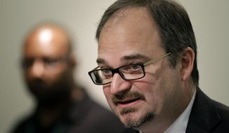 """FILE - In this April 17, 2012 file photo, Plaintiff's attorney Thomas Newkirk speaks during a news conference in Des Moines, Iowa.  Iowa continues to maintain an internal """"do not rehire"""" list of fired employees who are barred from returning to state employment, even though judges have raised questions about its legality, according to a review by The Associated Press. """"There's a lot of room for inconsistencies, favoritism, petty retribution, discrimination,"""" said Newkirk, who's analyzed the list. (AP Photo/Charlie Neibergall, file)"""