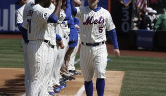 New York Mets' David Wright, right, greets teammates during opening day cermeonies before a baseball game against the Washington Nationals at Citi Field in New York, Monday, March 31, 2014.  (AP Photo/Seth Wenig)