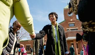 Councilmember and mayoral candidate Muriel Bowser greets District residents after attending a Washington Animal Rescue League 100th Anniversary celebration Monday. (andrew harnik/the washington times)