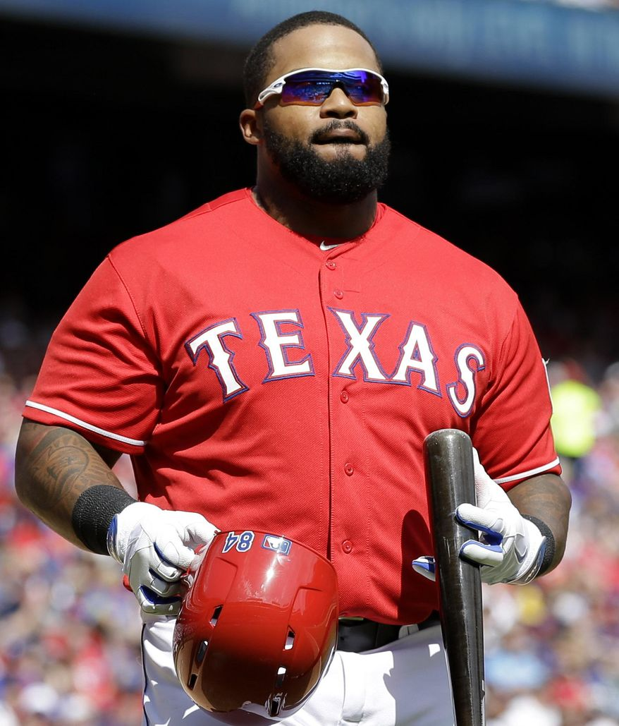 Texas Rangers' Prince Fielder heads to the dugout after being called out on strikes during the sixth inning of an opening day baseball game against the Philadelphia Phillies at Globe Life Park, Monday, March 31, 2014, in Arlington, Texas.  (AP Photo/Tony Gutierrez)