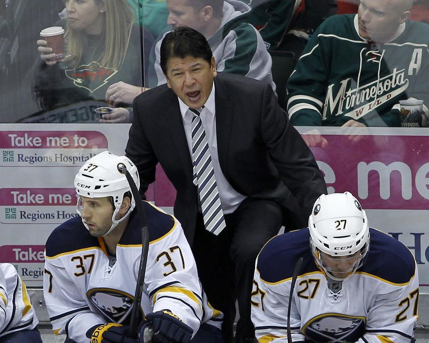"""FILE - In this Jan. 2, 2014 file photo, Buffalo Sabres interim head coach Ted Nolan disagrees with referee Darcy Burchell during the third period of an NHL hockey game against the Minnesota Wild in St. Paul, Minn.  Nolan will oversee the team's rebuilding plans beyond this season after signing a three-year contract extension on Monday, March 31, 2014. The team lifted Nolan's """"interim"""" tag from his title by announcing the signing on its Twitter page.  (AP Photo/Ann Heisenfelt, File)"""