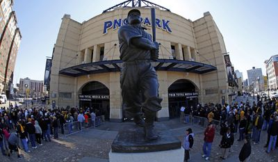 Baseball fans line up outside PNC Park near the statue of Hall of Fame Pittsburgh Pirates shortstop Honus Wagner before the opening day baseball game between the Pittsburgh Pirates and the Chicago Cubs on Monday, March 31, 2014, in Pittsburgh. (AP Photo/Gene Puskar)