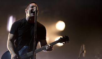 """In this March 27, 2014 photo, Trent Reznor of Nine Inch Nails performs at the Vive Latino music festival in Mexico City, Mexico. Reznor says he feels """"a fresh new start"""" for Nine Inch Nails after the band's latest album and world tour. (AP Photo/Rebecca Blackwell)"""