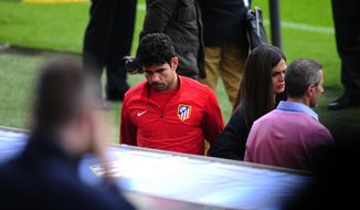 Atletico Madrid's Diego Costa, leaves the training session at the Camp Nou stadium in Barcelona, Spain, Monday, March 31, 2014. FC Barcelona will face Atletico Madrid in a first leg quarter-final Champions League soccer match April 1. (AP Photo/Manu Fernandez)