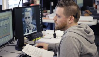 Joshua Truax talks with an applicant at MNSure's call center in St. Paul, Minn., Monday, March 31, 2014. Monday is the open enrollment deadline for signing up for insurance under the health care act. (AP Photo/Ann Heisenfelt)