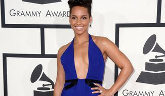 FILE - This Jan. 26, 2014 file photo shows singer Alicia Keys at the 56th annual Grammy Awards at Staples Center in Los Angeles.  Keys will receive the Inspiration award at the annual DVF awards Friday evening in a ceremony at the United Nations. (Photo by Jordan Strauss/Invision/AP, File)