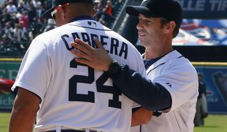 Detroit Tigers manager Brad Ausmus, right, greets first baseman Miguel Cabrera before the baseball game against the Kansas City Royals in Detroit, Monday, March 31, 2014. Detroit's 4-3 win on opening day was Ausmus' first win as a Tigers manager. (AP Photo/Carlos Osorio)