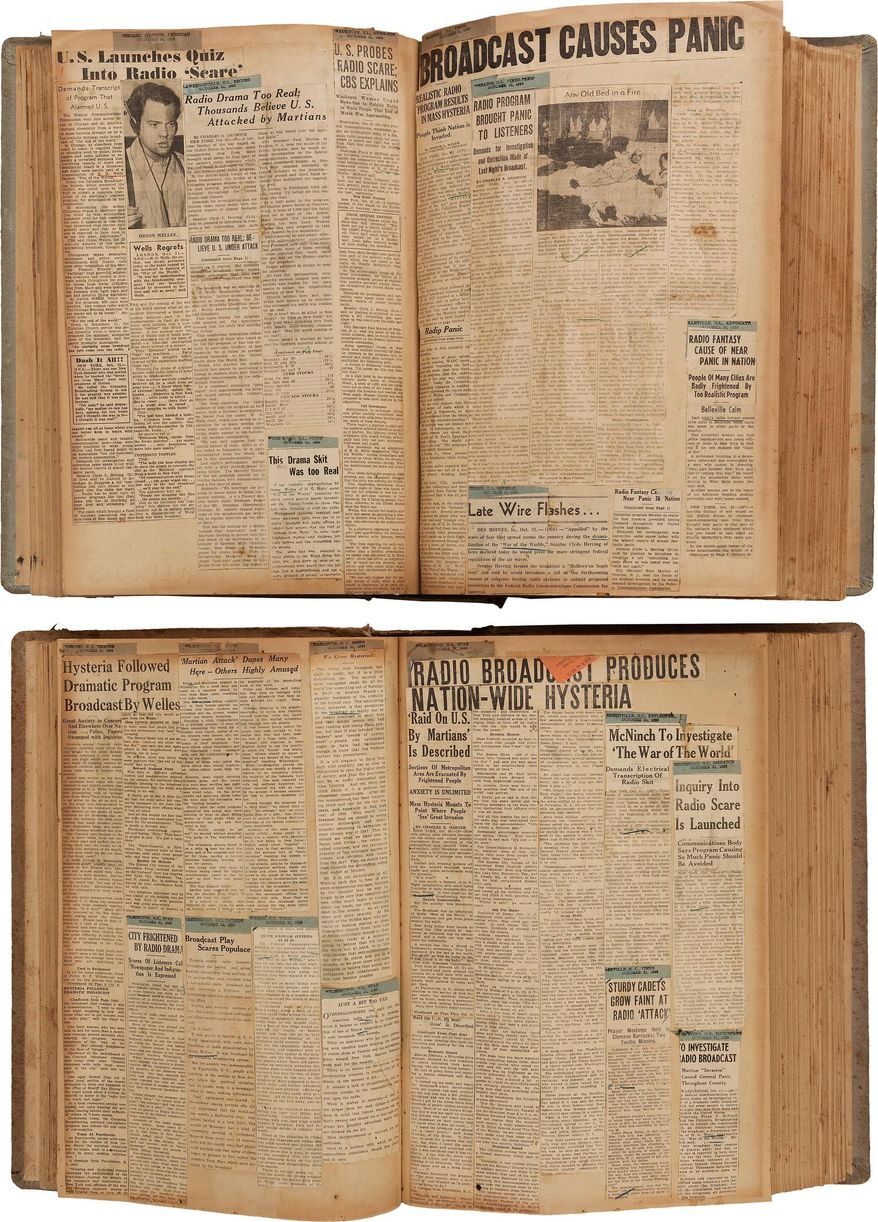 "This photo provided by Heritage Auctions shows two scrapbooks filled with newspaper clippings about the nationwide panic from Orson Welles' 1938 radio broadcast of ""War of the Worlds""  which are among the Welle's items consigned by his daughter, Beatrice, that will be offered by Heritage Auctions in New York City on April 26, 2014.  (AP Photo/Heritage Auctions)   Photo credit:"