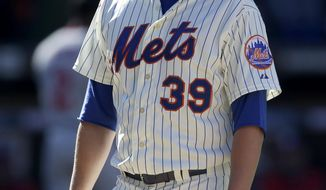 New York Mets relief pitcher Bobby Parnell reacts as he leaves the field during the ninth inning of the baseball game against the Washington Nationals on Opening Day at Citi Field in New York, Monday, March 31, 2014.  The Nationals defeated the Mets in extra innings 9-7. (AP Photo/Seth Wenig)