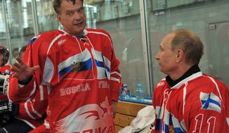 Russian President Vladimir Putin, right, and Finnish President Sauli Niinisto take part in a friendly ice hockey match in Igora resort near in St. Petersburg, Russia, Friday, June 22, 2012. (AP Photo/RIA-Novosti, Alexei Nikolsky, Presidential Press Service)