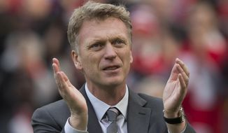 Manchester United's manager David Moyes applauds supporters after his team's 4-1 win against Aston Villa in their English Premier League soccer match at Old Trafford Stadium, Manchester, England, Saturday March 29, 2014. (AP Photo/Jon Super)