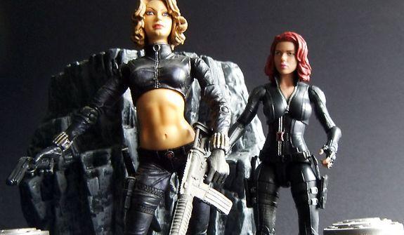 Hasbro's S.H.I.E.L.D. Agent Natasha Romanoff looks upon Diamond Toys' 2003 version of Marvel Comics' Black Widow (Yelana Belova). (Photograph by Joseph Szadkowski / The Washington Times)