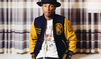 """In this March 25, 2014 photo, Pharrell Williams poses in Los Angeles. NBC has signed Williams as a coach for the upcoming seventh season of its musical competition series """"The Voice."""" Earlier this year, Williams scored an Oscar nomination for his song """"Happy"""" from the film """"Despicable Me 2."""" He has had a Grammy-winning collaboration with Daft Punk on the dance hit """"Get Lucky."""" (Photo by Casey Curry/Invision/AP)"""