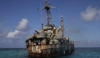 A dilapidated Philippine Navy ship LT 57 (Sierra Madre) with Philippine troops deployed on board is anchored off Second Thomas Shoal, locally known as Ayungin Shoal, Sunday, March 30, 2014 off South China Sea.  On Saturday, China Coast Guard attempted to block the Philippine government vessel AM700 carrying fresh troops and supplies, but the latter successfully managed to docked beside the ship to replace troops who were deployed for five months. (AP Photo/Bullit Marquez)