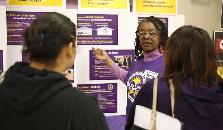 ** FILE ** Volunteer Stella Chambers, center, explains some of the Affordable Health Care Act to visitors to a health care coverage registration site hosted by Service Employees International Union-United Healthcare Workers, Monday, March 31, 2014, in Sacramento, Calif. (AP Photo/Rich Pedroncelli)
