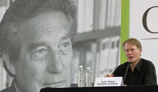 Nobel Prize Literature Laureate Jean-Marie Gustave Le Clezio, usually identified as J. M. G. Le Clezio, speaks  during a press conference in Mexico City, Saturday, March 29, 2014. Le Clezio participated in the celebrations of the Centennial Anniversary of the birth of his friend, Mexican author Octavio Paz. (AP Photo/Berenice Bautista)
