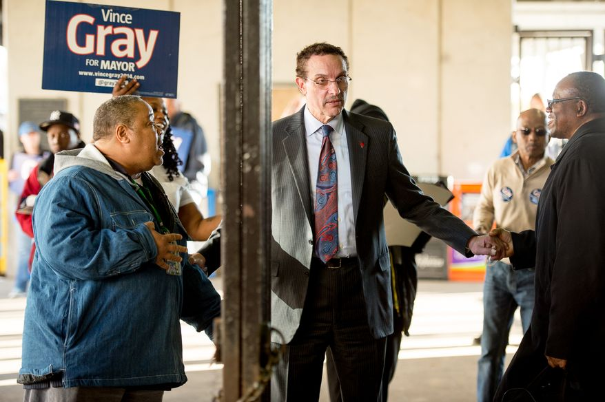 D.C. Mayor Vincent Gray shakes hands with District residents at the Rhode Island Metro Station the night before election day, Washington, D.C., Monday, March 31, 2014. (Andrew Harnik/The Washington Times)