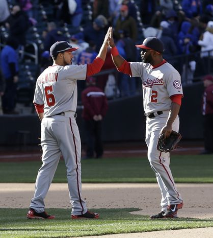 Washington Nationals' Denard Span, right, and Anthony Rendon celebrate their win after the baseball game against the New York Mets on Opening Day at Citi Field in New York, Monday, March 31, 2014. The Nationals defeated the Mets in ten innings 9-7. (AP Photo/Seth Wenig)