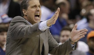 Washington Wizards head coach Randy Wittman directs his team against the Charlotte Bobcats during the second half of an NBA basketball game in Charlotte, N.C., Monday, March 31, 2014. The Bobcats won 100-94. (AP Photo/Chuck Burton)
