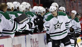 Dallas Stars center Tyler Seguin, right, celebrates his goal with his teammates in the first period of an NHL hockey game against the Washington Capitals, Tuesday, April 1, 2014, in Washington. (AP Photo/Alex Brandon)