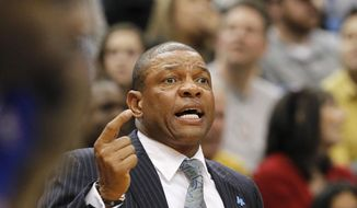 Los Angeles Clippers head coach Doc Rivers gestures to his players during the first quarter of an NBA basketball game against the Minnesota Timberwolves in Minneapolis, Monday, March 31, 2014. The Clippers won 114-104. (AP Photo/Ann Heisenfelt)