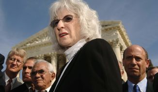 FILE - In this Tuesday, Nov. 1, 2005, file photo, Nancy Hollander, center, attorney for the members of Centro Espirita Beneficente Uniao Do Vegetal, speaks at a news conference on the steps of the Supreme Court, in Washington. Hollander is representing Army Pvt. Chelsea Manning in her court-martial appeals. Hollander says the soldier's 35-year sentence for leaking classified information is out of proportion with the offenses of which she was convicted. (AP Photo/Kevin Wolf, File)