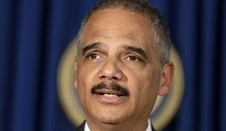 U.S. Attorney General Eric Holder speaks during a news conference in New York, Tuesday, April 1, 2014. Holder says the successful prosecution of Osama bin Laden's son-in-law in New York shows terror trials can be safely held in the United States.(AP Photo/Seth Wenig)