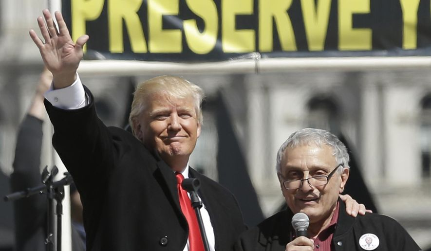 Donald Trump, left, and Carl Paladino, who ran for governor of New York as a Republican in 2010, speak during a gun rights rally at the Empire State Plaza on Tuesday, April 1, 2014, in Albany, N.Y. (AP Photo/Mike Groll)