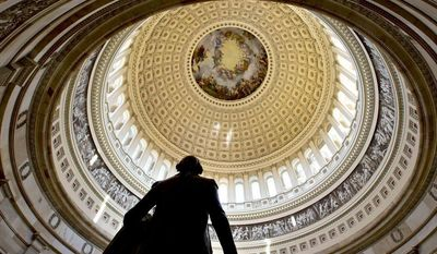** FILE ** A statue of President George Washington is seen in the foreground at the Rotunda of the U.S. Capitol. (AP Photo/J. Scott Applewhite)