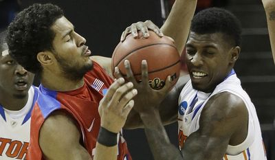 Florida forward Casey Prather (24) holds the ball as Dayton forward Devin Oliver (5) defends during the second half in a regional final game at the NCAA college basketball tournament, Saturday, March 29, 2014, in Memphis, Tenn. (AP Photo/Mark Humphrey)