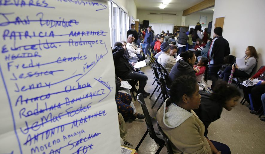 A waiting area is filled with applicants waiting to be called during a health care enrollment event at the Bay Area Rescue Mission, Monday, March 31, 2014, in Richmond, Calif. Whether it's a chance for a subsidy or to avoid a tax penalty, Californians are making a last-minute dash to sign up for health coverage. Midnight marks the enrollment deadline under President Barack Obama's health reform law. Covered California, the state's insurance exchange, is reporting a final surge after it already had enrolled more than 1 million people for individual policies. (AP Photo/Eric Risberg)