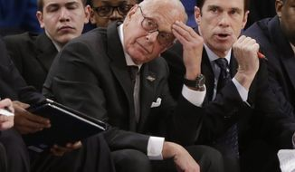 SMU head coach Larry Brown reacts during the first half of an NCAA college basketball game against Clemson in the semifinals of the NIT Tuesday, April 1, 2014, in New York. (AP Photo/Frank Franklin II)