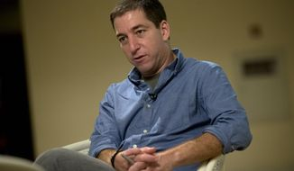 FILE - In this July 14, 2013 file photo, journalist Glenn Greenwald speaks during an interview with The Associated Press in Rio de Janeiro. Greenwald, the journalist most associated with the coverage of Edward Snowden's leak of phone and Internet surveillance by the National Security Agency, will be this year's recipient of the University of Georgia's McGill Medal for Journalistic Courage, the school announced Monday, March 31, 2014. (AP Photo/Silvia Izquierdo, File)
