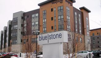 This photo taken on Tuesday, April 1, 2014, shows the exterior of BlueStone Lofts, an apartment complex built across from the University of Minnesota Duluth last year.  The complex offers high-end rental units to students and others. With Duluth's rental vacancy rate below 2 percent, a recent study found the city needs to add 1,000 new housing units in the next three years, and another 1,300 by 2020. (AP Photo/Minnesota Public Radio, Dan Kraker)
