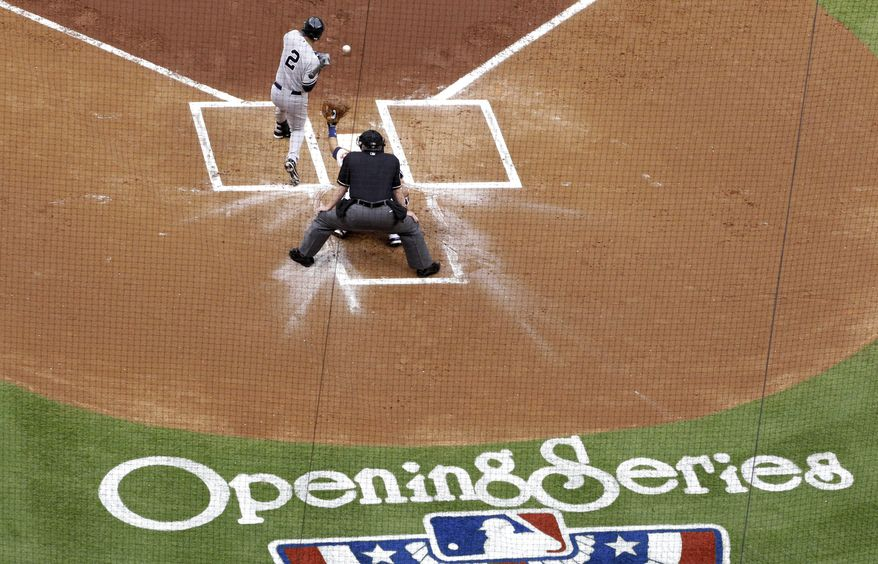 New York Yankees' Derek Jeter is hit by a pitch in the first inning of a baseball game against the Houston Astros, Tuesday, April 1, 2014, in Houston. (AP Photo/Patric Schneider)