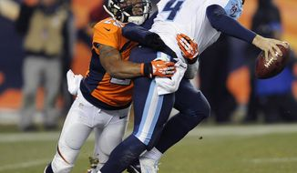 FILE  - In a Sunday, Dec. 8, 2013 file photo, Denver Broncos cornerback Chris Harris Jr. sacks Tennessee Titans quarterback Ryan Fitzpatrick in the fourth quarter of an NFL football game, in Denver. The Denver Broncos announced Tuesday, April 1, 2014 that  that Harris Jr. signed his restricted free agent tender contract. Harris is recovering from a torn anterior cruciate ligament.  (AP Photo/Chris Schneider, File)