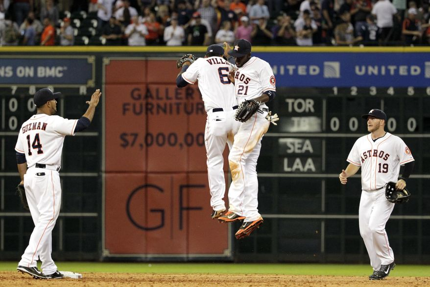 Houston Astros' Jesus Guzman (14), Jonathan Villar (6), Dexter Fowler (21) and Robbie Grossman (19) celebrate a 6-2 victory over the New York Yankees in a baseball game, Tuesday, April 1, 2014, in Houston. (AP Photo/Patric Schneider)