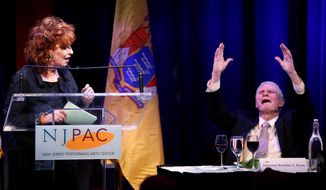 Former New Jersey Gov. Brendan Byrne, right, reacts to a joke by comedian Joy Behar during a celebrity comedy roast in honor of Byrne's 90th birthday, Tuesday, April 1, 2014, in Newark, N.J. (AP Photo/Julio Cortez)