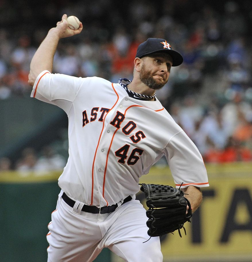 Houston Astros' Scott Feldman delivers a pitch against the New York Yankees in the first inning of a baseball game Tuesday, April 1, 2014, in Houston, on opening day for the teams. (AP Photo/Pat Sullivan)
