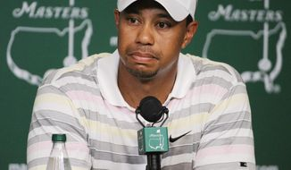 FILE - In this April 5, 2010 file photo, Tiger Woods listens to a question during his news conference at the Masters golf tournament in Augusta, Ga. Woods will miss the Masters for the first time in his career after having surgery on his back. Woods said on his website that he had surgery Monday, March 31, 2014, in Utah for a pinched nerve that had been hurting him for several months. (AP Photo/Harry How, Pool, File)
