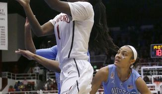 Stanford guard Lili Thompson (1) shoots against North Carolina guard Latifah Coleman (2) and forward Stephanie Mavunga, left rear, during the first half of a regional final of the NCAA women's college basketball tournament in Stanford, Calif., Tuesday, April 1, 2014. (AP Photo/Jeff Chiu)