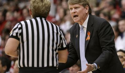 North Carolina coach Andrew Calder, right, argues with an official during the first half of a regional final against Stanford at the NCAA women's college basketball tournament in Stanford, Calif., Tuesday, April 1, 2014. (AP Photo/Jeff Chiu)