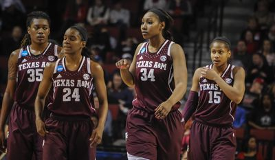 Texas A&M's Achiri Ade (35),  Jordan Jones (24), Karla Gilbert (34) and Tori Scott (15) during the second half of their Monday March 31, 2014 regional final against Connecticut in the NCAA college basketball tournament in Lincoln, Neb.(AP Photo/Dave Weaver)