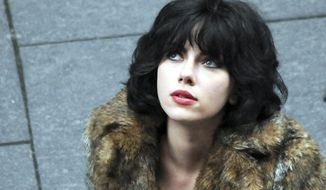 "This image released by A24 Films shows Scarlett Johansson in a scene from ""Under the Skin."" (AP Photo/A24 Films)"