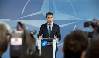 NATO Secretary General Anders Fogh Rasmussen gestures while speaking during a media conference ahead of a meeting of the North Atlantic Council at NATO headquarters in Brussels on Tuesday, April 1, 2014. NATO foreign ministers begin a two-day meeting on Tuesday in which they will discuss, among other issues, the situation in Ukraine. (AP Photo/Virginia Mayo)