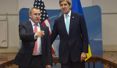 U.S. Secretary of State John Kerry, right, meets with Ukrainian Foreign Minister Andriy Deshchytsia before their meeting at NATO Headquarters in Brussels, Tuesday April 1, 2014. (AP Photo/Jacquelyn Martin, Pool)