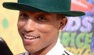 Pharrell Williams arrives at the 27th annual Kids' Choice Awards at the Galen Center on Saturday, March 29, 2014, in Los Angeles. (Photo by Dan Steinberg/Invision/AP)